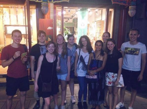 Student group photo outside a restaurant in Beijing