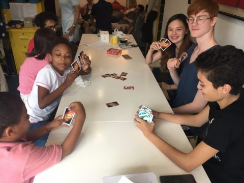 Young students playing Uno