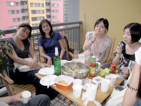 Group of people having breakfast at the LTL Beijing terrace