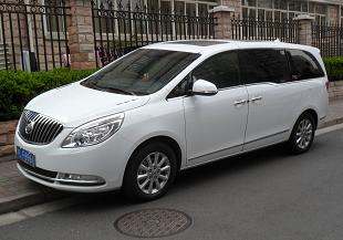 White Buick GL8 minivan parked on the street