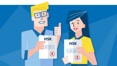 two students holding up their HSK diplomas