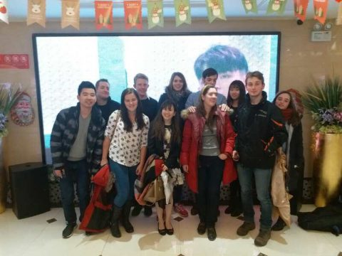 Georgia and other students in front of a huge screen