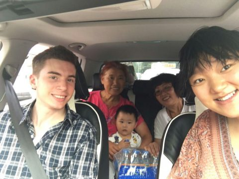 Student in a car with his homestay family