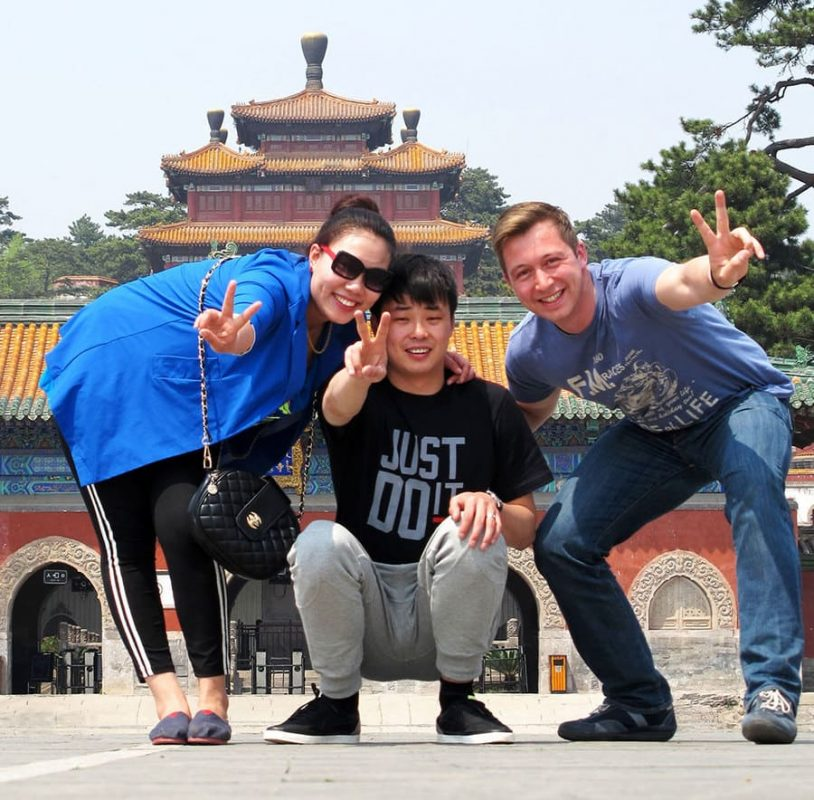 Three people posing in front of a temple in Chengde
