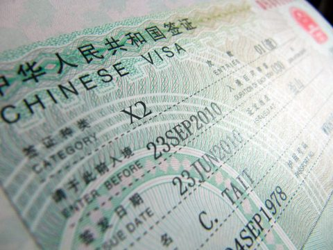 Close up of a Chinese X2 visa in a passport