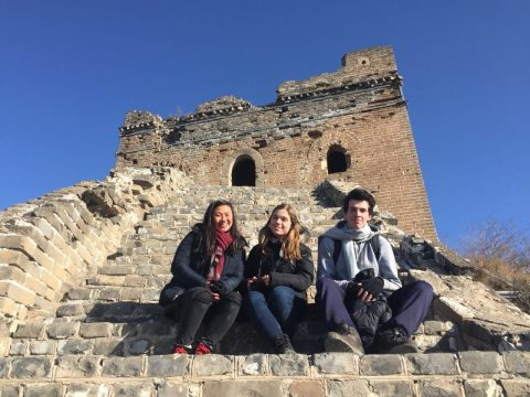 Three students sitting at the steps on the Great Wall of China