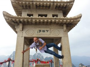 Mohamed climbing one of China's sacred mountains
